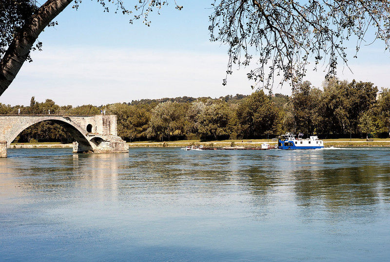 Pushing gravel barge past the Avignon Bridge<br /> Avignon, France