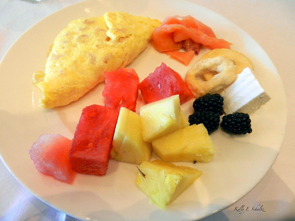 Champagne Brunch at the hotel.  The hotel offered Mimosas but I requested pineapple juice with my champagne, after seeing Anthony Bourdain drink it.  (I highly recommend it).  Anyway, here is my breakfast portion of the brunch: smoked salmon, dried apples, soft cheese, black berries, pineapples, watermelon & a shrimp and cheese omelette.