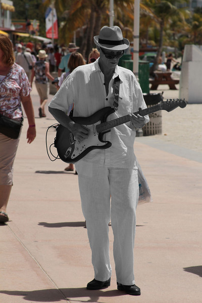 OLD ROCKERS NEVER DIE, THEY JUST FADE AWAY. This was taken on the Dutch side of St. Martin. He was just into his music as all the tourists from the Cruise Ships scurried about the beach and shops. He played great. Talk about a dream job.