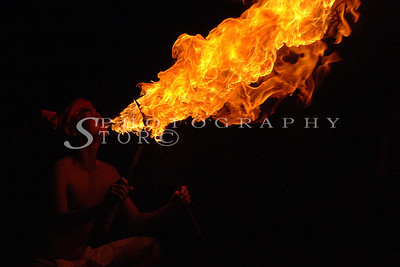 Fire thrower performing in the Chiang Mai streets parade during Lantern Festival.