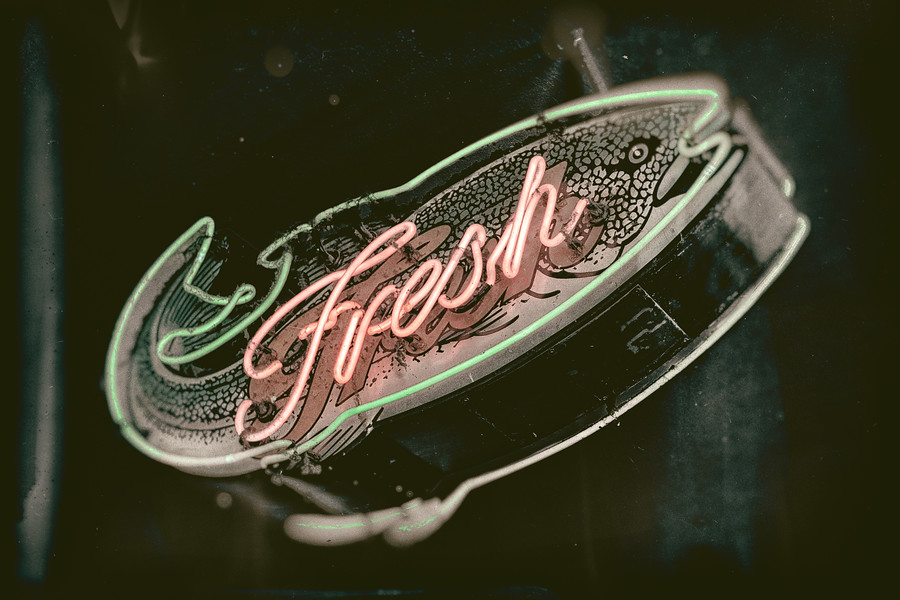 Neon Fresh Fish Sign at Pike Place Market in Seattle, WA