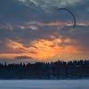 Snowkiting over the frozen seas in the sunset, just outside our  residence in Helsinki.
