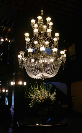 Chandelier and flower arrangement inside the hotel's lobby