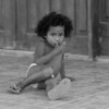A child left alone at a church near a main roadway.  No adults within 200 ft.