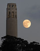 "June 2007's ""Blue Moon"" rises against Coit Tower in San Francisco, CA."