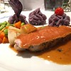 Pork loin in orange sauce.