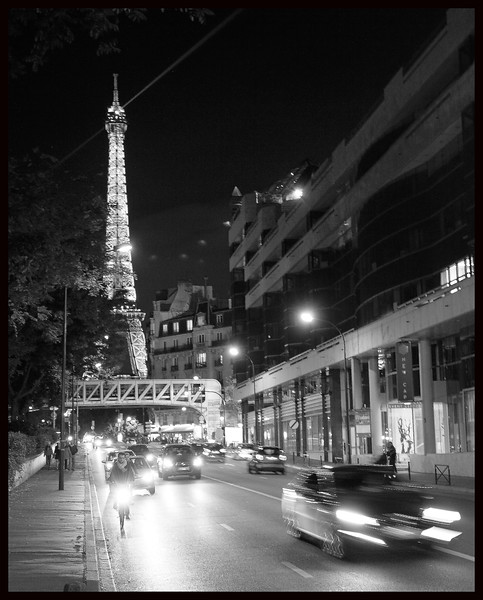 Zooming past the Tower on Rue de Rivoli
