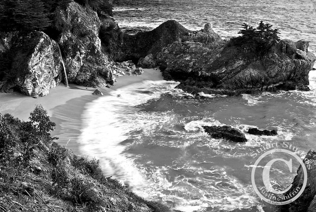 McWay Cove<br /> <br /> This stormy afternoon set the scene at McWay Falls.  Using a long exposure helped bring enough detail out of the dark rocks and also nicely captured the waves.<br /> <br /> Ago vita vos somnium (live the life you dream)