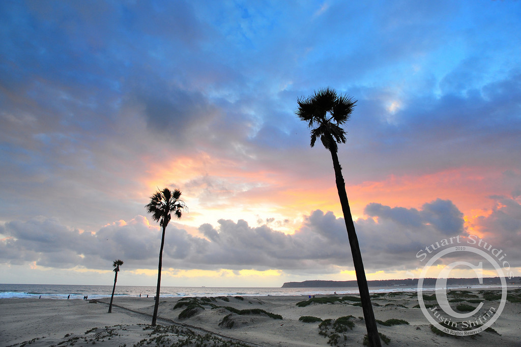"Breaking Coronado Storms  Last week the winter ""rains"" stopped in San Diego and the image above perfectly illustrates the waning storm-front.   The low-lying clouds blocked harsh direct sunlight and enabled my camera to properly register the pink and blue hues left by a fading sun.    Another beautiful day gone.  March 17, 2010"