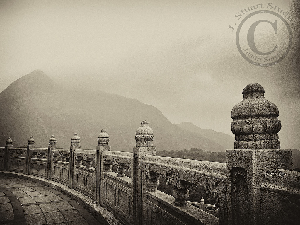 Tian Tan Vista<br /> <br /> This photograph was taken at the Tian Tan Buddha on Lantau Island in Hong Kong.  What a serene setting!  This sepia-converted image from a Canon S90 leaves a timeless imprint.<br /> <br /> Ago vita vos somnium (live the life you dream)