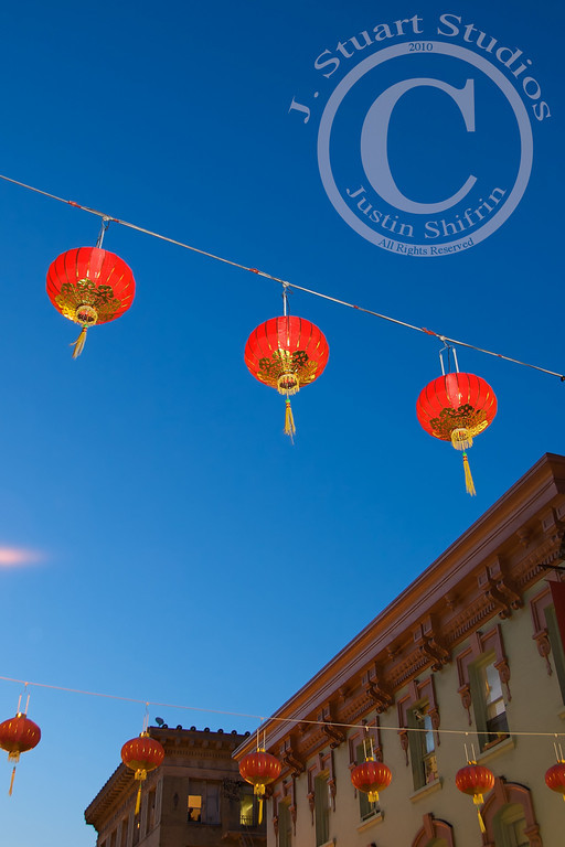 Chinatown Hang  The sun was about to set on San Francisco when I grabbed by camera and power-walked to one of my favorite destinations in the Bay Area, Chinatown.  Chinatowns across the country are filled with culture.  The pungent aromas, vibrant colors, distinct architecture, and the almost <i>requisite</i> hanging lanterns provide ample sensory stimulation.    San Fransisco's Chinatown did not disappoint!  The red hanging lanterns pictured above were helped by a pop of fill-flash.  April 28, 2010