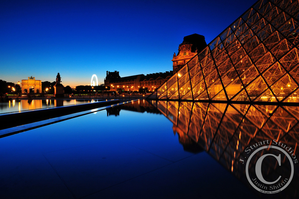 Peaceful Paris<br /> <br /> As dusk washed over Europe, the crowds of tourists seemingly vanished from the Louvre grounds, leaving the square serenely silent.  If only this photograph could fully convey the experience!  <br /> <br /> Ago vita vos somnium (live the life you dream)