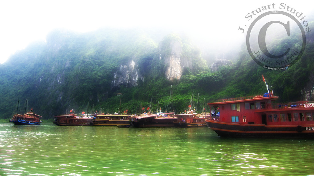 Ha Long Harbour Mist<br /> <br /> This snapshot was enhanced with some computer generated filters to convey the magical harbour that our tour boat docked in.  The photograph is almost as good as the view in person.<br /> <br /> Ago vita vos somnium (live the life you dream)