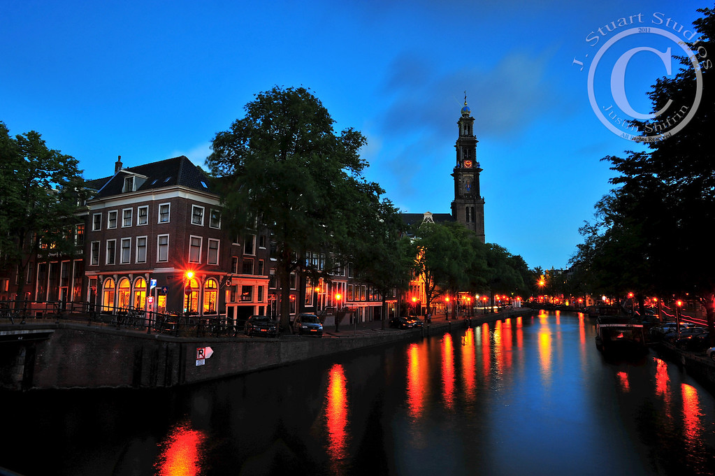 Northwest Corner of Canal & Canal<br /> <br /> Dancing lights.  Smooth clouds.  A long exposure, neutral density filter and perfect scenery enabled this Dutch photograph to be pleasing.  <br /> <br /> <br /> Ago vita vos somnium (live the life you dream)