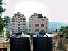 water tanks on Palestinian houses are a necessity since the Israelis only give them water twice a week.