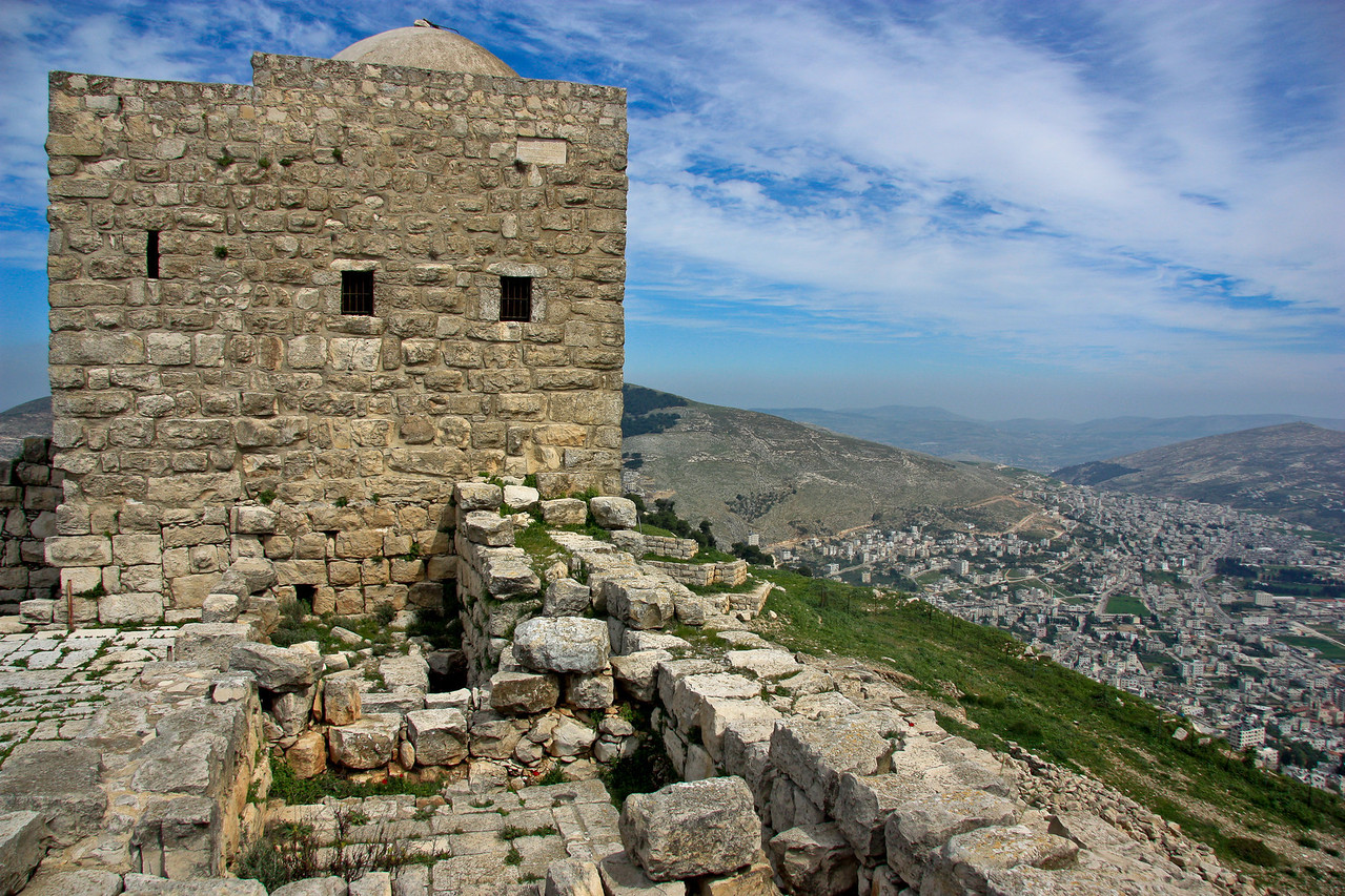 Nablus. Our first stop in the West Bank. 1st C.  Somarian ruins on top of Mt. Garizim.  The Sumarians were here when the Hebrews moved in - 3048.This is the place where Jesus washed the feet of a Sumarian woman.Here lies another rock where Abraham went to sacrifice Isaac. Sameria is in no country, it is under the control of the Palestinian Authority as of 1994.