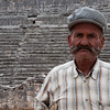 This man came up to me at Xanthos, a ruined Roman town in the backroads of southwest Turkey. He really wanted me to know that the British had taken the orginal frieze on top of a pillar and that UNESCO would get it back for them so they could get rid of the plaster copy now on site. He then surprised me by sweeping away a pile of soil to reveal Roman era tile mosaics.