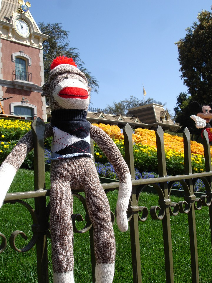 Sock Monkey shares the frame with Mickey.