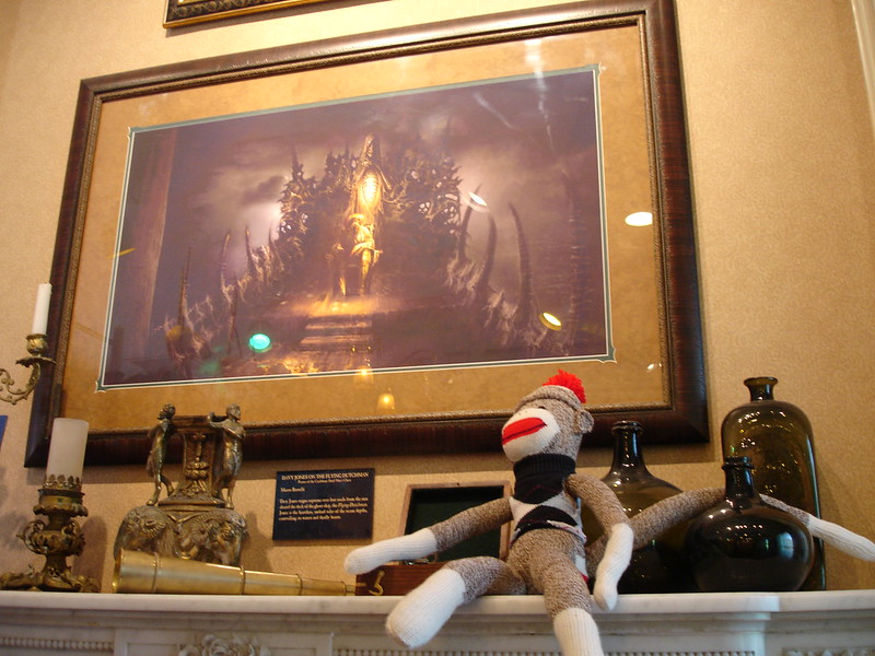 Sock Monkey appreciates the art and artifacts displayed on the mantel of the Disney Gallery fireplace.