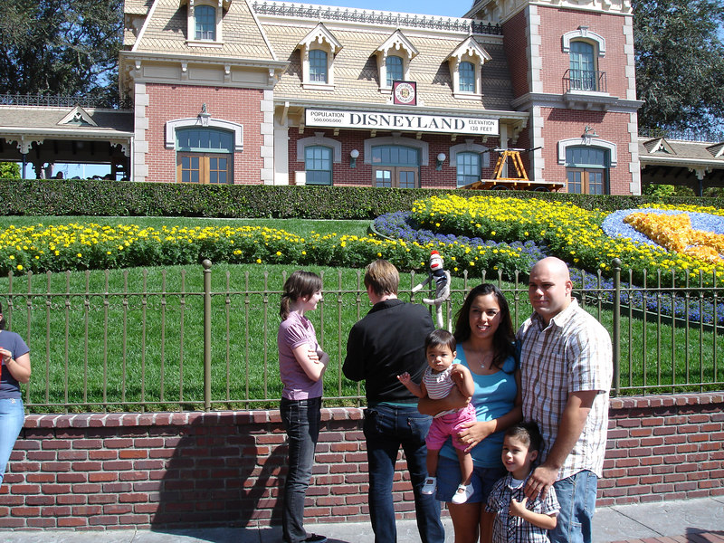 Chelsea and Winslow set up Sock Monkey for this first snapshot just inside the Disneyland entrance. Beautiful unknown family in foreground!