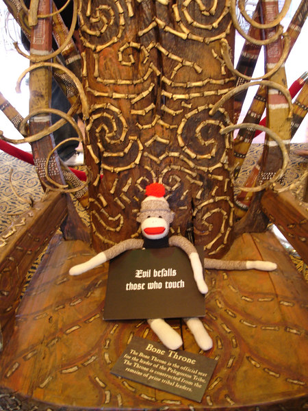 A gallery attendant invited Sock Monkey to sit on the Bone Throne.