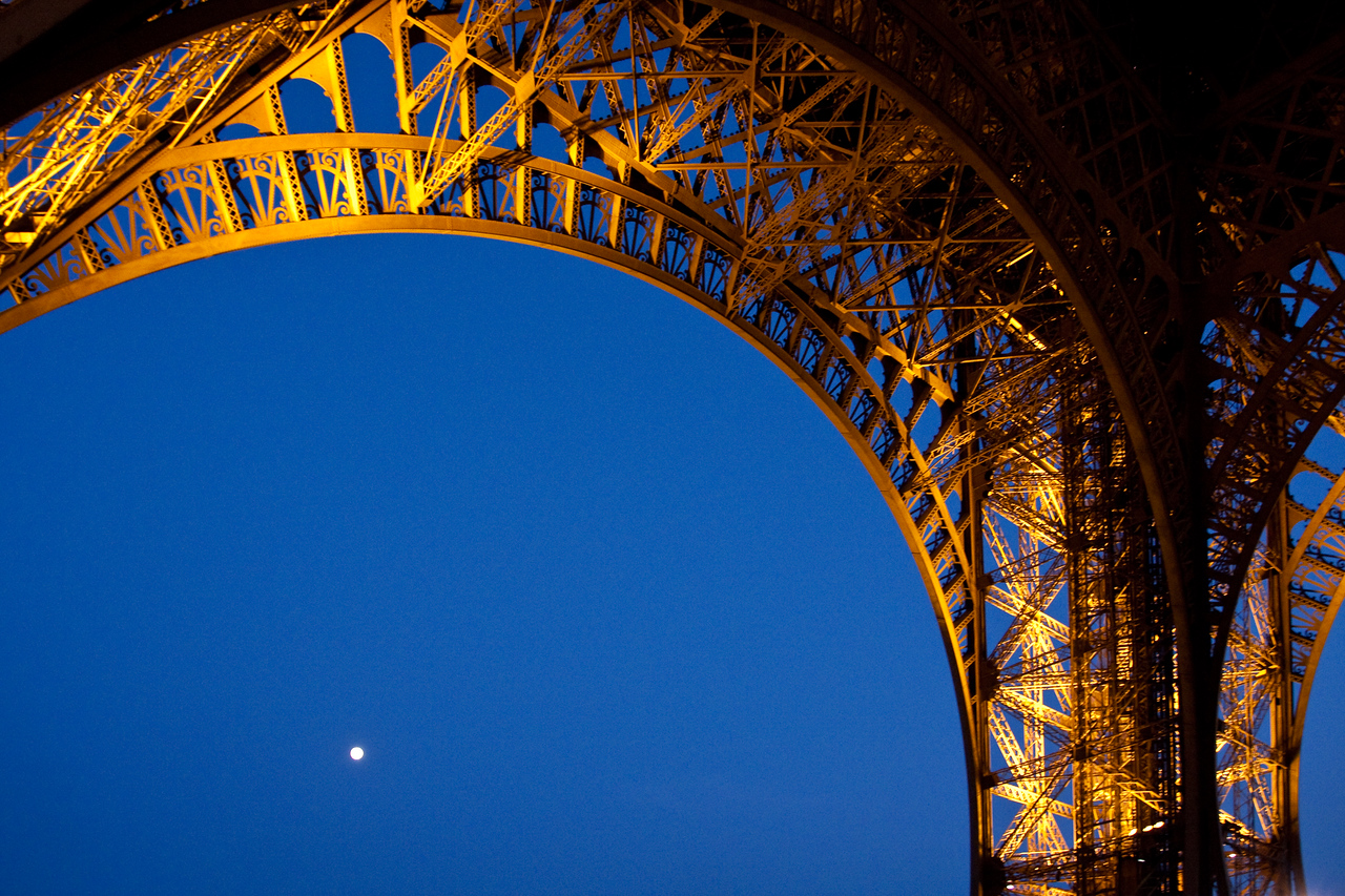 The moon under the legs of the Eiffel Tower