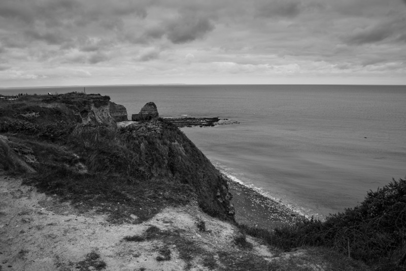 "Point du Hoc.  The United States Army Rangers scaled these cliffs under heavy fire to destroy the large guns on top.  The guns wee not installed.  The sight was heavily bombed about USAF and USS Navy.  There are still very larger craters at the sight that were caused by the 14"" guns of the USS Texas."