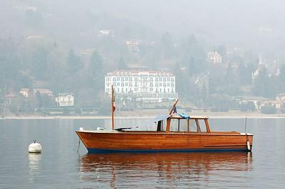 boat and villa, photo taken from Isola Pescatori