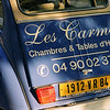 Advertising Les Carmes on a classic French auto.