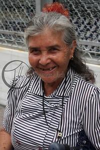 Well, ok. She has a beautiful smile! San Salvador, El Salvador.