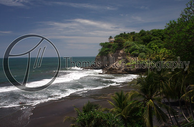 This is part of my travels with Elmo. Probably one of the most beautiful black sand beaches that I have ever seen. Make sure to bring sandals because that sand is hot! El Sunsal, El Salvador.