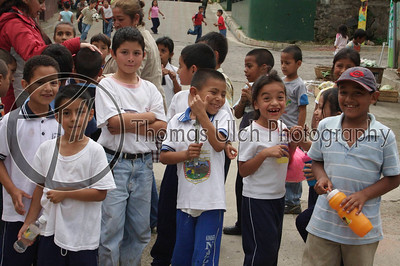 """A group of Salvadoran school children. I especially like the smile on the girl's face and the big guy in the middle with his arms crossed keeping his eye on the """"gringo loco"""". Apaneca, Ahuachapan, El Salvador."""