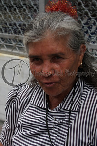 This woman was with her granddaughter. When I started to take their photo, the granddaughter was...lets say less than pleased.  However, grandma has no problem with it at all. Although, she was a little skeptical at first.  San Salvador, El Salvador.