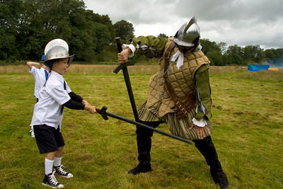 Young boys practice the art of sword fighting