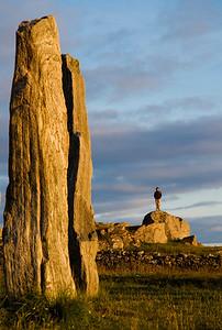 visitor to Calanais stones, Lewis, Scotland