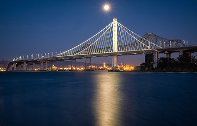 Full moon over the new eastern span of the Bay Bridge - old span behind.  3/15/2014