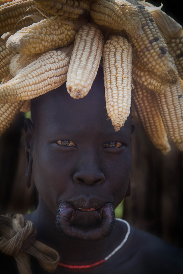 Mursi woman with corn headress