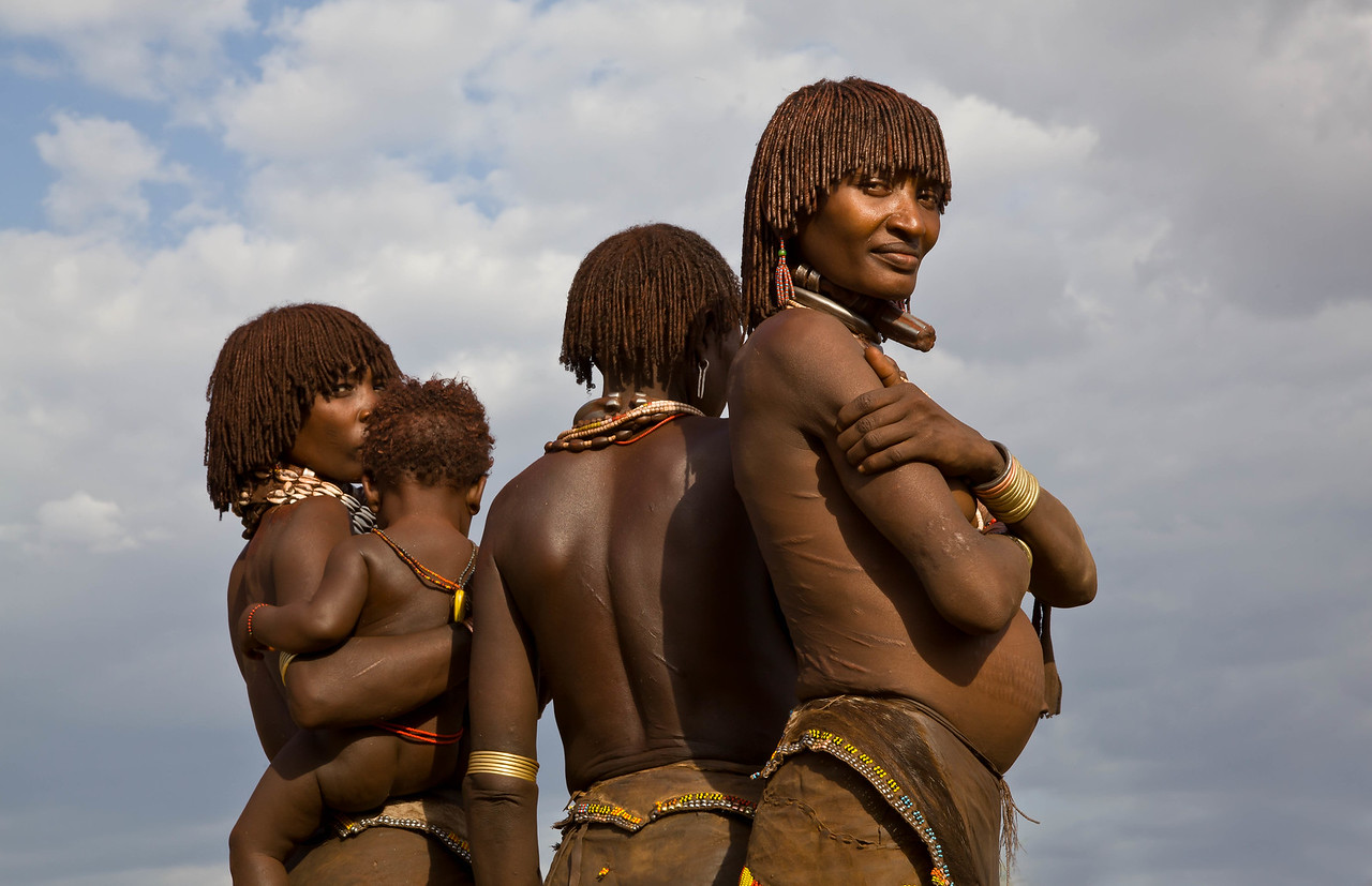 Hamar mothers showing back scarification from whipping ceremony
