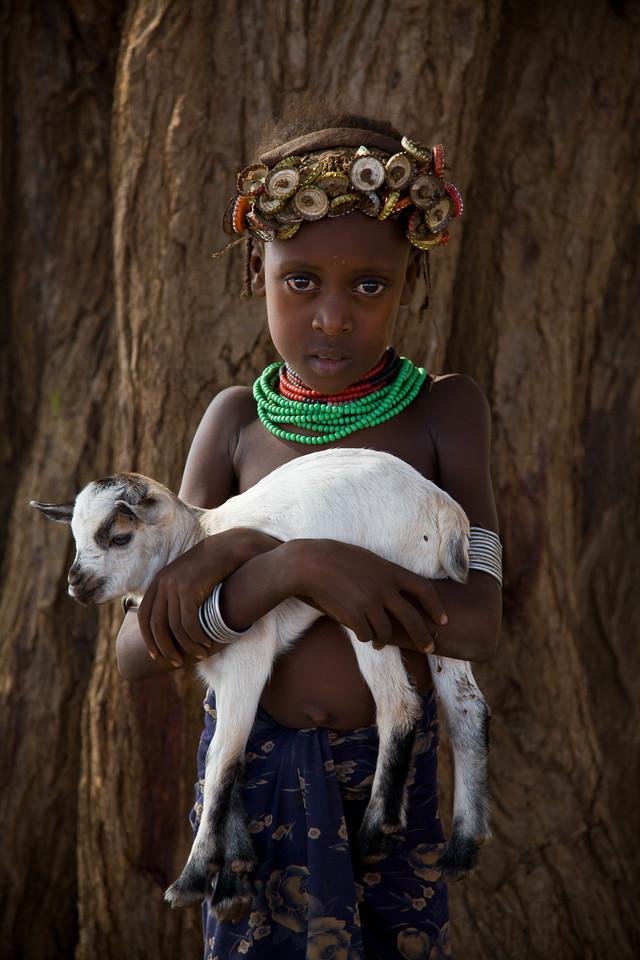 Nyangatom girl and baby goat