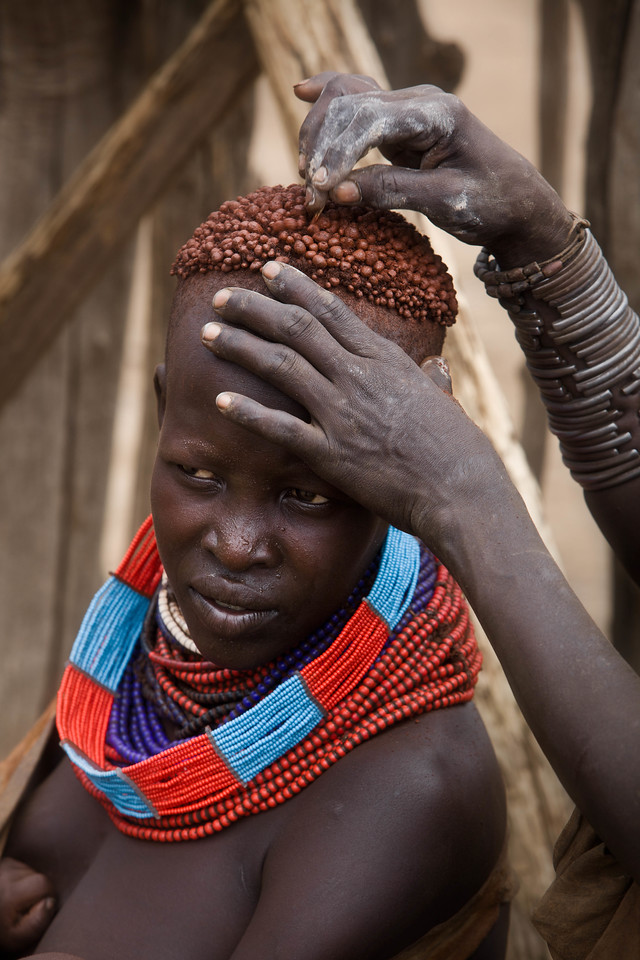 Karo woman having hair cleaned