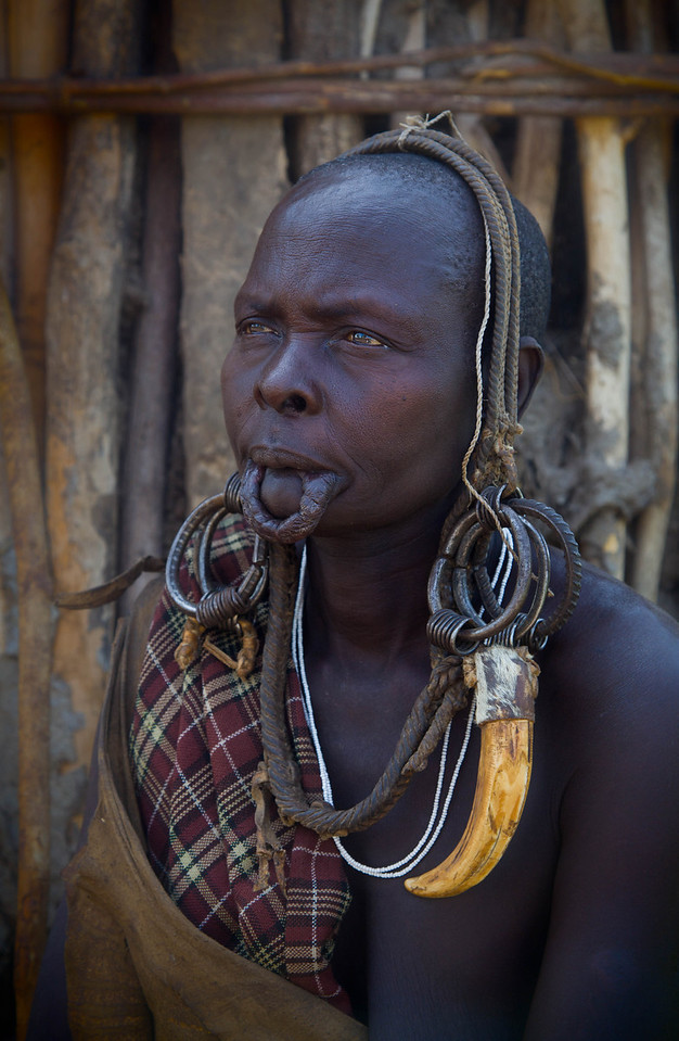 Mursi woman with traditional headress