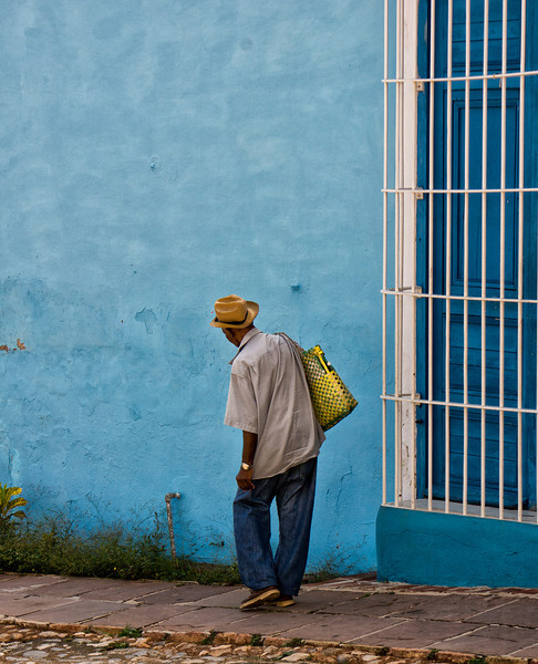 Man against blue wall