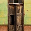 Wooden door, green wall