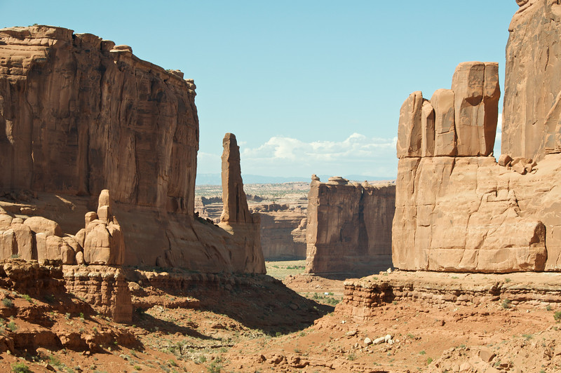 Arches National Park.  There is grey van on the road in this pic.