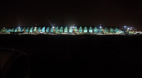 We land in Dubai, alongside its huge air terminal.