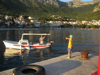 This little boy waited for over 30 minutes for what i presume is his father to return from fishing, lovely sunset, Gradac, Croatia