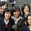 Japanese Schoolgirls and their teach on holiday at the Sinjosi temple.