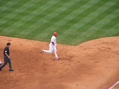Jogging round the bases after the home run.