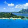 Aerial View of Bora Bora with Mount Otemanu in background and coral reef. Photo by Christian Wilkinson.