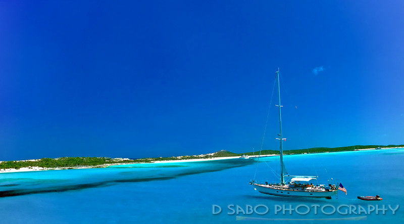 """Come Sail Away""  Sailboat heads towards shore on a deserted caye outside the Exuma Islands"